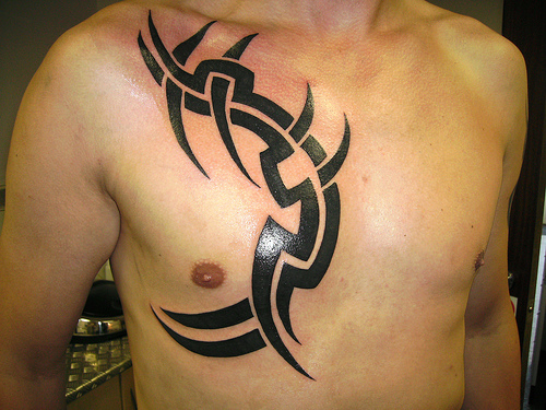 For men usually get tribal tattoos on their neck, back, shoulder blades
