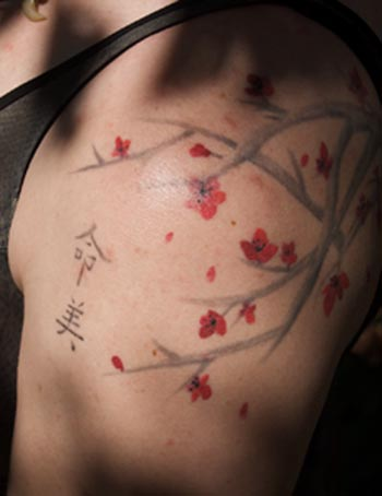 cherry blossom tattoo. cherry blossom tattoo.