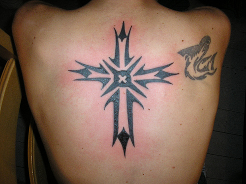 Crosses made as cross tribal tattoos or