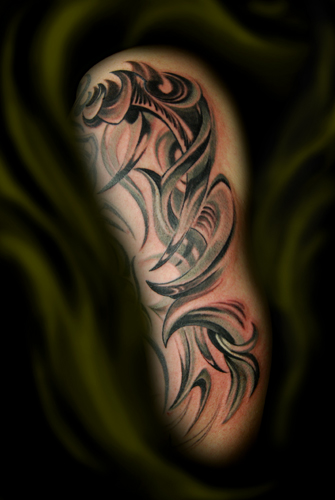 tribal arm tattoo of their