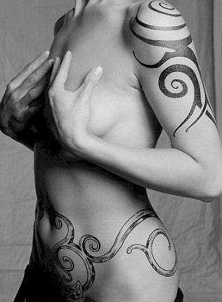 pictures of tattoos for women. side tattoos for women.